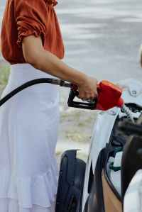woman fills up her car with fuel